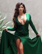 Carmen Ortega upskirt and showing huge cleavage in a green dress at the photosho