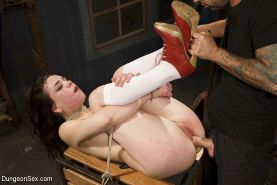 Juliette March is fucked in extreme rope bondage in a dark dungeon