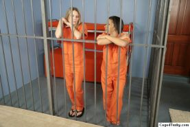 Hot lesbian action in a prison cell