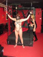 Private BDSM dungeon play of mature lesbian slave in bondage