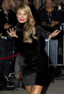 Stacy Keibler leggy wearing black mini dress at 'The Ides of March' premiere in