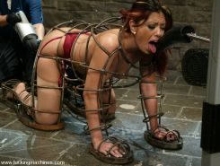 Satine gets machine fucked in a metal cage and cums nonstop