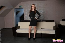 Linda Luv in sexy black dress and high heels strips and masturbates with blue vi