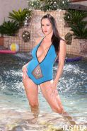 Carmella Bing strips off her blue swimsuit by the pool