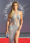 Jennifer Lopez braless and pantyless flashing her pussy in revealing silver dres