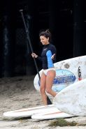 Eva Longoria enjous paddleboarding wearing white bikini bottom at the beach in M