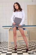 Nataly Von brunette lifts her skirt and toys fucks her pussy in a clinic room