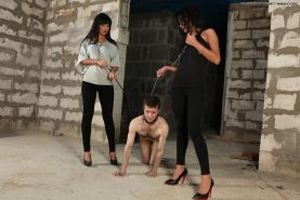 Two big strong Mistresses fucks a skinny boy in the ass
