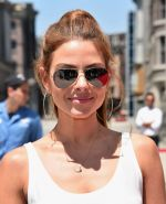 Maria Menounos looks hot in a tiny white top and shorts