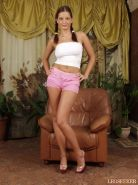 Sandra Shine poses in pink hot pants and heels and have fun with her toy