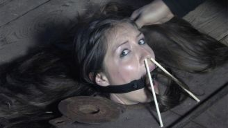 Trapped in the floor, first Sister Dee gets the ring gag, then she gets Mr. Pogo