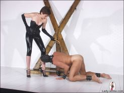 Rubber and leather dominatrix lady sonia milks a slaves cock dry