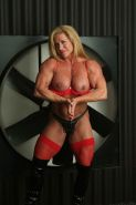 female bodybuilder showing off her huge muscles
