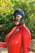 Latex Lucy is caged in latex outdoor by busty Ruby Rubber