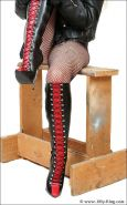 Leather latex mature biker babe in kinky boots