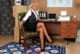 Busty secretary Lana Cox dildos in the office
