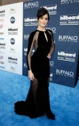 Emmy Rossum wearing black partially see-through maxi dress at the 2013 Billboard