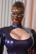 Latex Lucy pleasures two cocks in her latex maid outfit