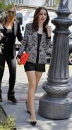 Lily Collins leggy wearing a leather shorts on the set of Extra in LA