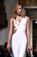 Karlie Kloss areola peek wearing a partially see through jumpsuit at the Versace
