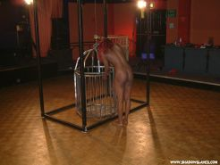 Caged bdsm and pain for kinky humiliated fetish slavegirl Emma Louise in stocks
