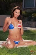 Cindy Hope brunette in american bikini is fingering pussy