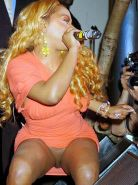 Lil Kim exposing her nice pussy upskirt and nipple slip paparazzi pictures