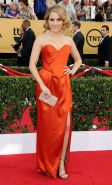 Sophia Bush shows huge cleavage wearing a strapless orange dress at the 21st Ann