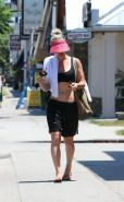 Kaley Cuoco busty in sports bra and shorts out in LA