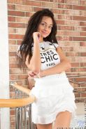 Sweet brunette teenie Dominika strips and showes her petite body