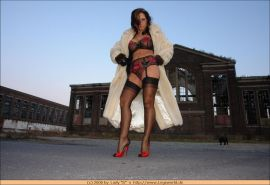 German lady in stockings and fur posing outdoor