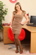 Jodie struts her stuff in brown and tan layered nylons