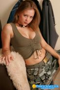 Busty Dawson Miller in green camo outfit and sheer panties