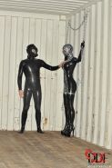 Latex Lucy in kinky outfit is chained and flogged
