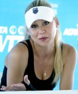 Anna Kournikova great cleavage in black dress