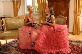 Hot lesbians wearing antique skirts and bustiers and fucking