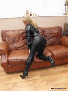Fetish wife in tight latex outfit and high heels
