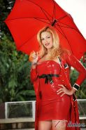 Blazing hot shemale in bright red latex