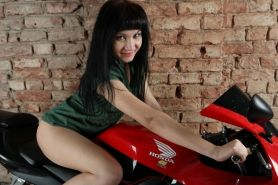 Hairy pussy Yana exposes goods on her motorcycle