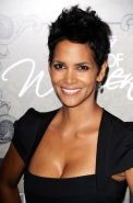 Halle Berry cleavy wearing a black low cut dress at Variety's Power of Women in
