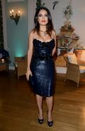 Salma Hayek busty wearing a low cut dress at Gucci  Vanity Fair Party in Cannes