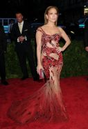 Jennifer Lopez pantyless wearing a side see through dress for the Costume Instit