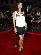 Catherine Bell very leggy in mini skirt and showing big cleavage