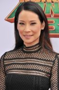 Lucy Liu busty and leggy in black mesh mini dress