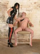 Male slave bound and cbt punished by his leather fetish femdom mistress