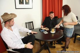 Two guys win at strip poker and the redheaded granny is getting cock deep in her
