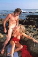 Blonde baywatch lifeguard suck cock on a public beach