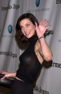 Terry Farrell exposing her nice big breast in see thru dress paparazzi pictures