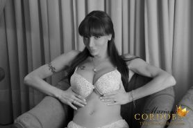 Tasty treat tranny Mariana Cordoba grabs that enormous shecock with both hands a