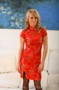Blonde strips red chinese minidress to reveal sexy black stockin